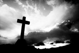 cross detail in silhouette and the clouds in the sky